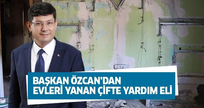 Başkan Özcan'dan evleri yanan çifte yardım eli