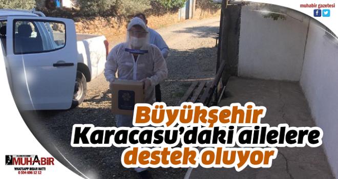 Büyükşehir Karacasu'daki ailelere destek oluyor