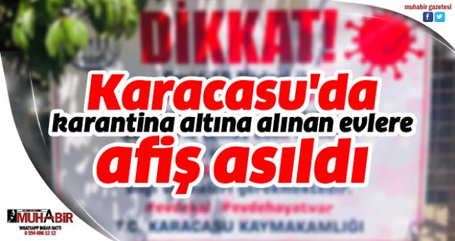 Karacasu'da karantina altına alınan evlere afiş asıldı