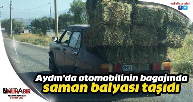 Aydın'da otomobilinin bagajında saman balyası taşıdı